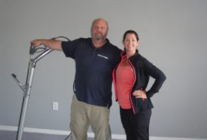 Lady & man getting ready to clean carpets Jacksonville Florida condo